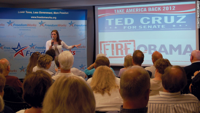 FreedomWorks' Amanda Shell shows activists examples of materials her organization designs, prints and distributes to local tea party groups.