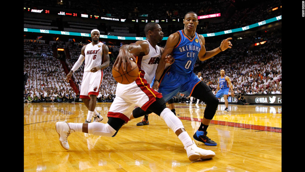 The Heat's Dwyane Wade tries to get past Russell Westbrook of the Thunder.