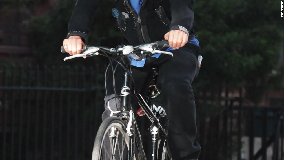 Woody Harrelson rides a bike around New York City.