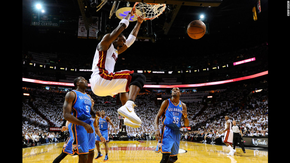 Chris Bosh of the Miami Heat dunks against the Oklahoma City Thunder in game three of the 2012 NBA Finals in Miami on Sunday, June 17. The Heat defeated the Thunder 91-85.