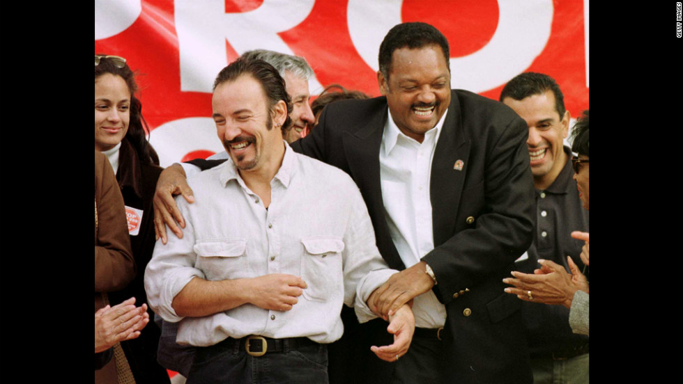 Springsteen is joined by the Rev. Jesse Jackson at a rally opposing Prop 209 in Los Angeles in 1996. The initiative was a ballot measure banning affirmative action by government in California.