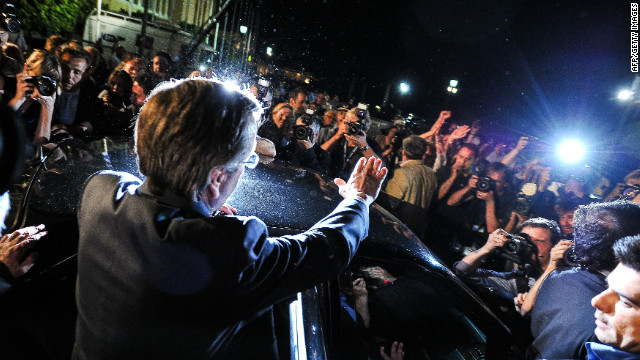 New Democracy party leader Antonis Samaras waves to supporters after a press conference in Athens, on June 17, 2012.