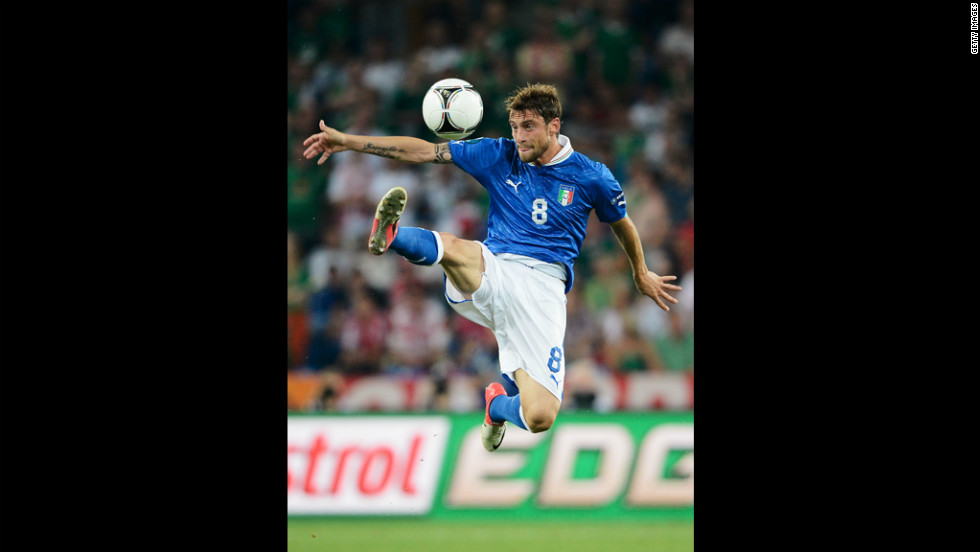Italy's Claudio Marchisio jumps to control the ball during the match against Ireland.