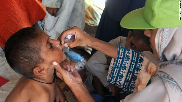 A Pakistan health worker gives polio drops at a makeshift camp on the outskirts of Karachi on September 29, 2010.