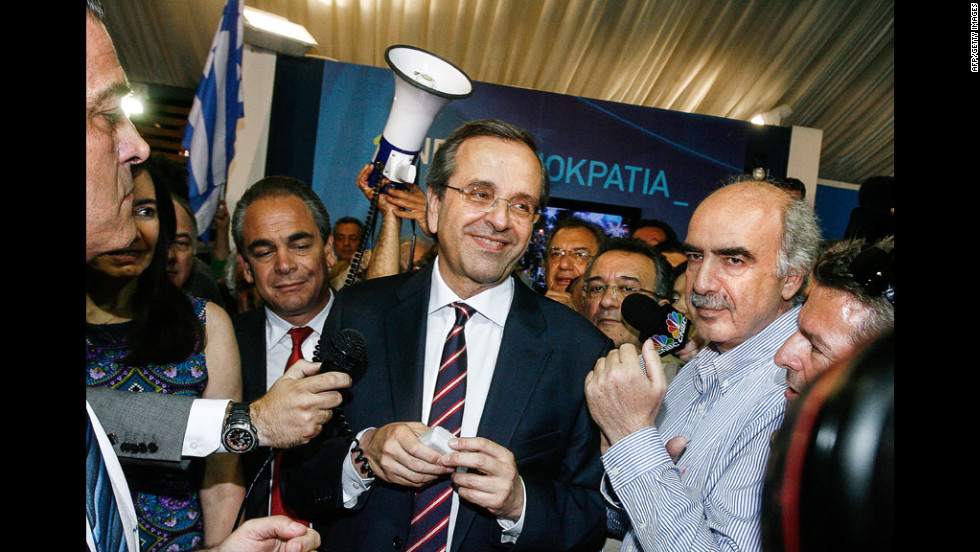 New Democracy leader Antonis Samaras smiles at supporters in Athens on Sunday, June 17. His center-right, pro-bailout party came out on top in the country's parliamentary elections.