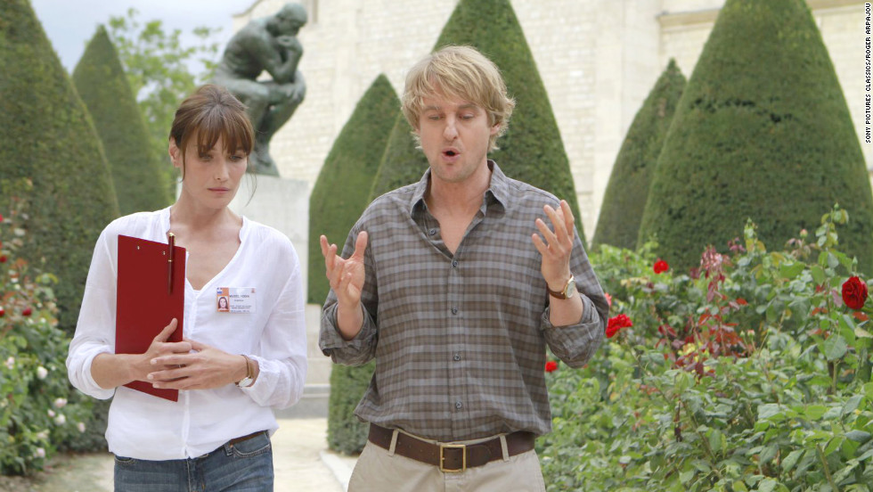 "Owen Wilson plays confused writer Gil in ""Midnight in Paris."" Here Gil discusses Auguste Rodin's work in the garden of the Musee Rodin with a tour guide played by Carla Bruni."