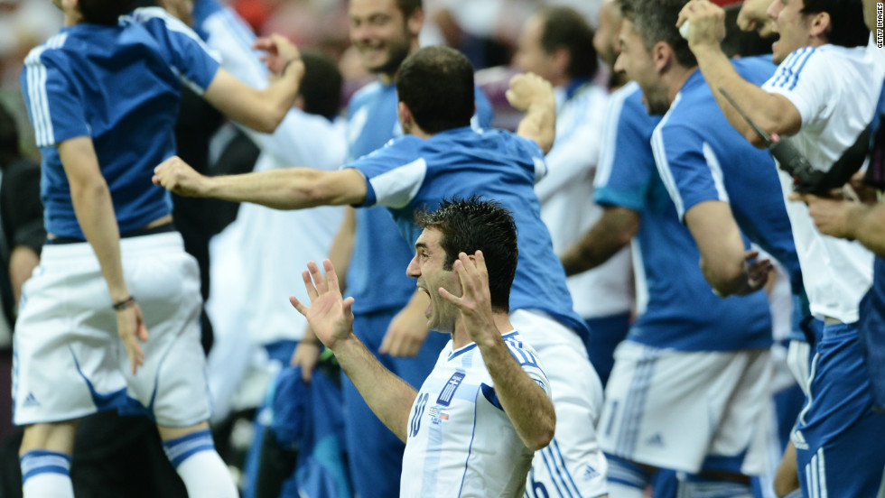 Karagounis, who asked to be substituted after being booked for diving, celebrated at the final whistle as the 1-0 win secured a clash with Germany.