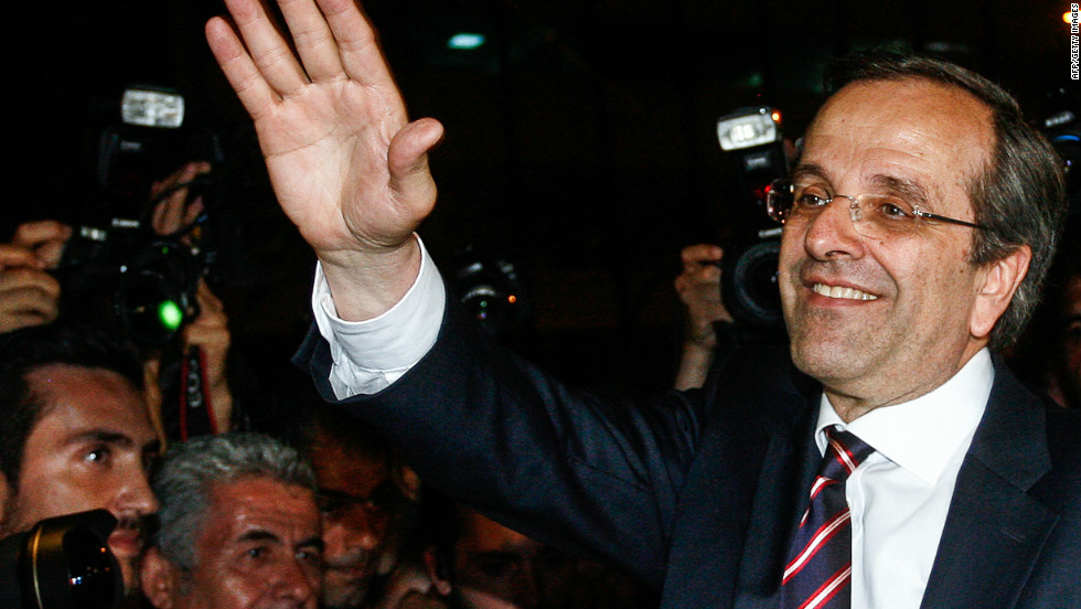New Democracy leader  Antonis Samaras hails his victory in Sunday's Greek elections. Samaras' party supports staying in the Euro and maintaining the austerity measures.