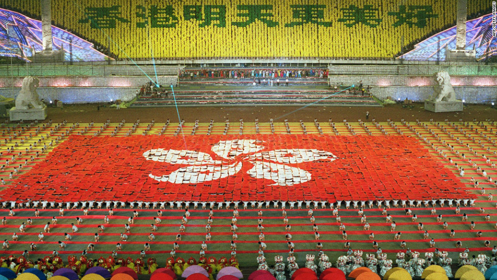 Perfomers in Beijing form the new Hong Kong flag at a rehearsal for a gala performance in honor of Hong Kong's return to Chinese rule. President Jiang Zemin was due to attend the performance on the evening of July 1 after returning from the handover ceremony in Hong Kong.