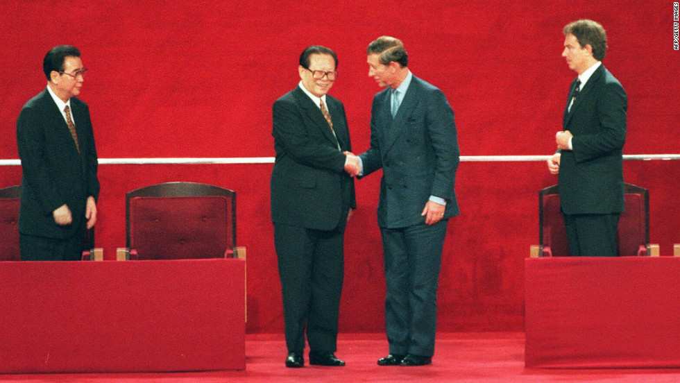 Chinese President Jiang Zemin (2nd L) shakes hands with Britain's Prince Charles (2nd R) following Hong Kong's transfer of sovereignty from British to Chinese rule.