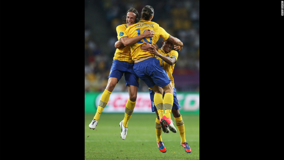 Zlatan Ibrahimovic of Sweden celebrates his goal with Jonas Olsson, left, and Martin Olsson during the match between Sweden and France.