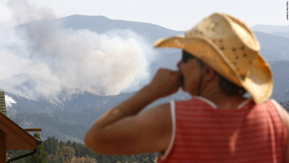 Jessie Couillard watches the High Park Fire a few miles from her house in Glacier View Meadows, northwest of Fort Collins, on Monday, June 18. The lightning-ignited wildfire that started June 9 has destroyed nearly 200 homes.
