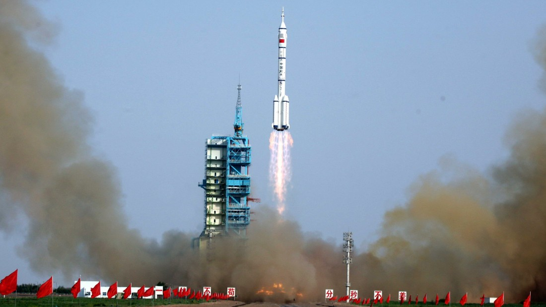 The Shenzhou-9 -- China's fourth manned space mission -- blasts off at 1037 GMT from the Jiuquan space base, northwest China's Gansu province in the remote Gobi desert on June 16, 2012.