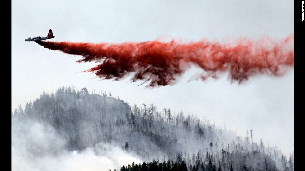 "A heavy air tanker drops fire retardant on the blaze June 19. Its growth potential was ""extreme,"" according to authorities."