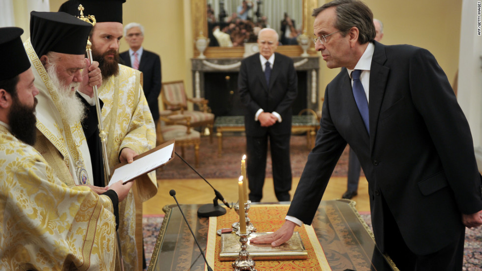 New Democracy leader Antonis Samaras is sworn in as Greece's new prime minister during a ceremony at the presidental palace in Athens on June 20, 2012.