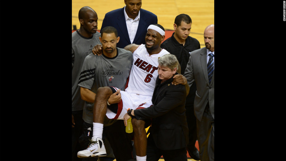 Injured LeBron James of the Miami Heat is carried off the court.