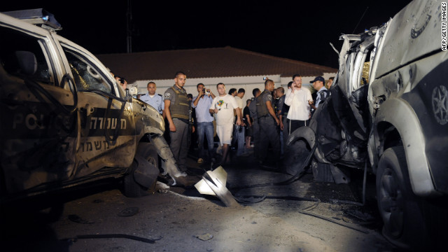 The remains of a rocket launched from Gaza are embedded in the ground Tuesday near the kibbutz of Yad Mordechay.