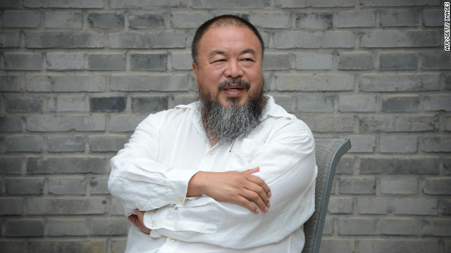 Chinese artist Ai Weiwei waits at his home after claiming he was barred from attending a court hearing in Beijing on June 20, 2012.