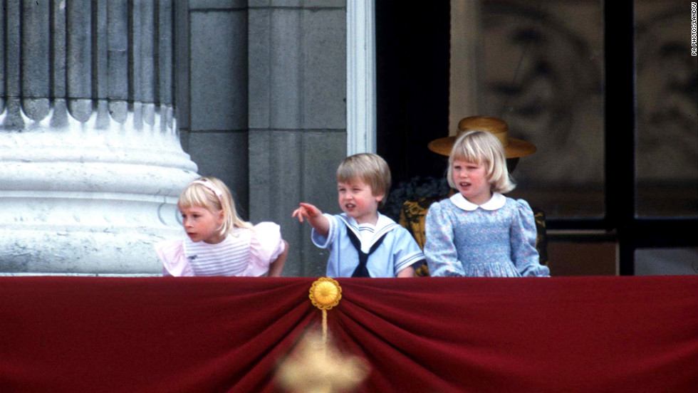 From the balcony of Buckingham Palace, a young Prince William watches the Trooping of the Color in 1985 with Lady Gabriella Windsor, left, and Lady Zara Phillips.