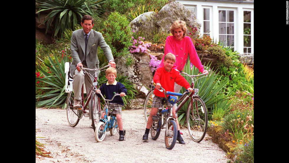 Prince William and Prince Harry ride bicycles with their parents in 1989 while on holiday in the Scilly Isles.