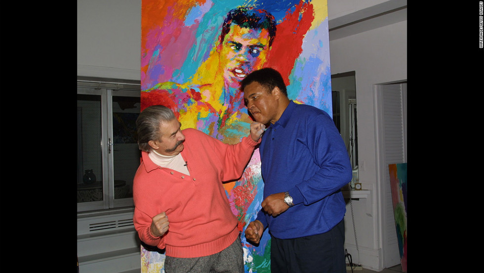 "Muhammad Ali and  Neiman clown around during Ali's visit to Neiman's New York studio to see his newest serigraph ""Muhammad Ali-Athlete of the Century"" in 2001."