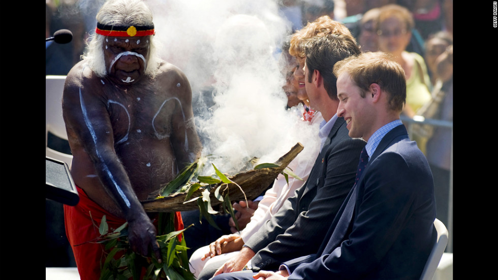 During his first official overseas visit, Prince William is welcomed to Sydney with a traditional smoke ceremony by local Aboriginal elder Uncle Max in 2010.