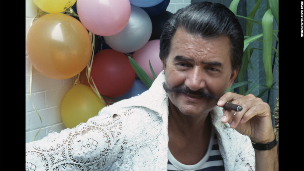 Neiman, known for his trademark handlebar mustache, smokes a cigar at an event in 1981.