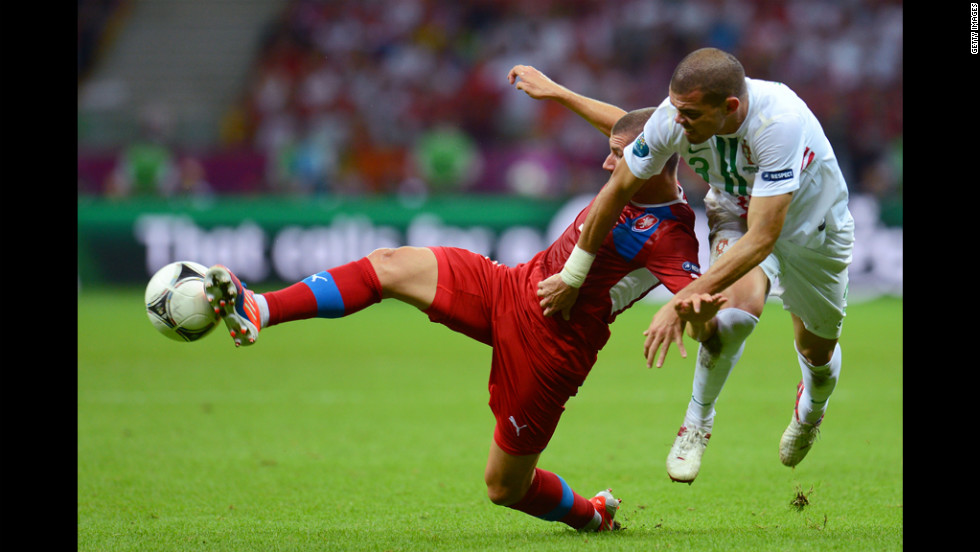 Jan Rezek of Czech Republic and Pepe of Portugal battle for the ball during the quarterfinal match between Czech Republic and Portugal on Thursday, June 21.