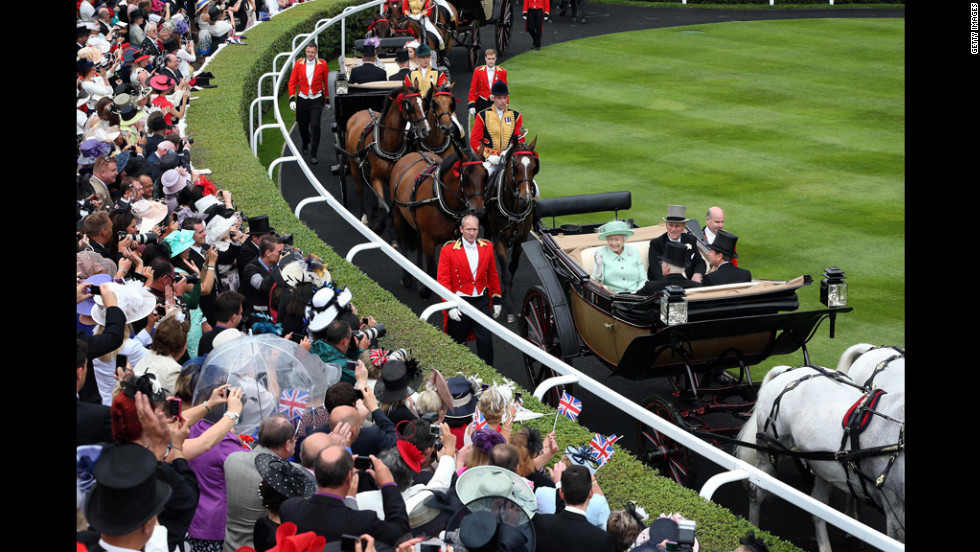 Queen Elizabeth II and Prince Philip, Duke of Edinburgh, and other members of the royal familly arrive in the Parade Ring at the Royal Ascot on Ladies Day on Thursday, June 21. Ladies Day is traditionally the fashion highlight of the five-day race meeting.