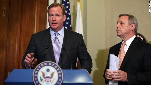 NFL Commissioner Roger Goodell speaks to journalists after meeting with Senate Majority Whip Dick Durbin (D-Illinois), right.