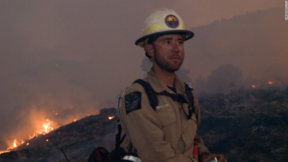 A firefighter battles the Little Bear Fire on June 14 at Lincoln National Forest.