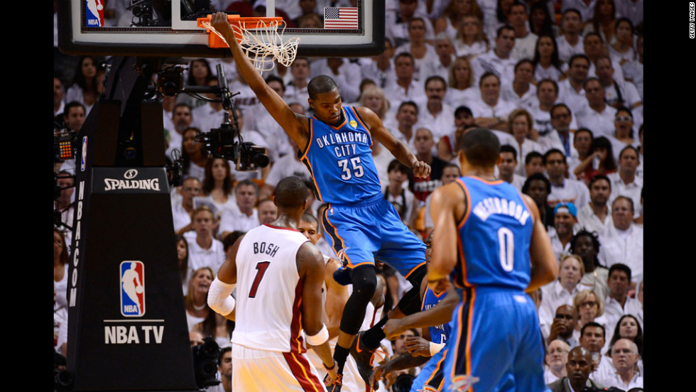 "Kevin Durant, No. 35 of the Thunder, hangs on the rim after a dunk in the first half against the Heat. View photos from <a href=""http://www.cnn.com/2012/06/19/us/gallery/nba-finals-game-iv/index.html"">Game four of the NBA Finals</a>."