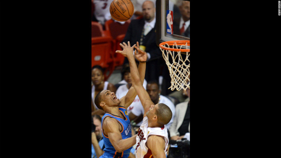 Shane Battier, right, of the Heat and Russell Westbrook, left, of the Thunder vie for the ball.