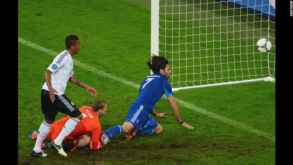 Georgios Samaras of Greece scores the team's first goal past Manuel Neuer of Germany.
