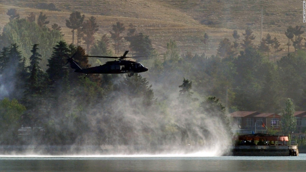 A Black Hawk helicopter flies near the hotel. The seige came nearly a year after an insurgent strike on Kabul's Hotel Inter-Continental killed nine attackers and 12 others.