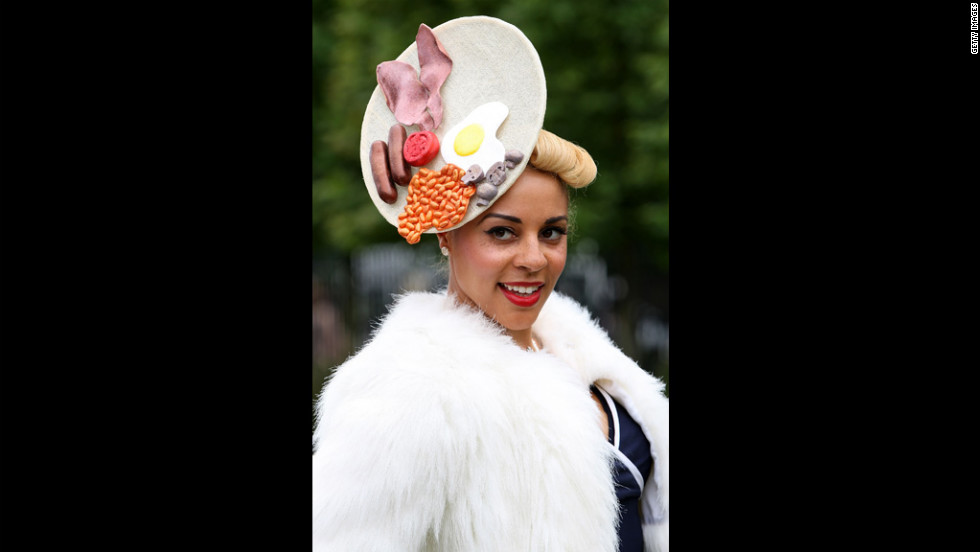 A woman shows off her unusual hat.
