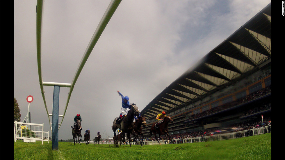 Frankie Dettori riding Colour Vision, center, to win the Gold Cup.