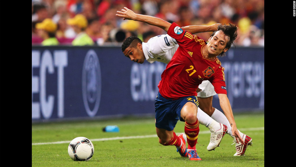 Gael Clichy of France and David Silva of Spain contend for the ball.