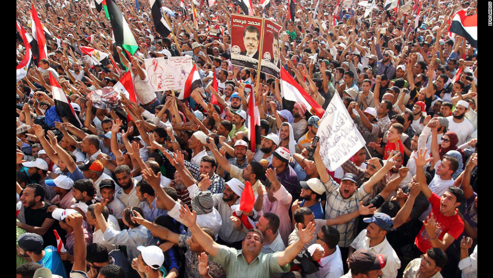Muslim Brotherhood supporters cheer in Cairo's Tahrir Square on Sunday after hearing of Morsi's victory in Egypt's presidential election.