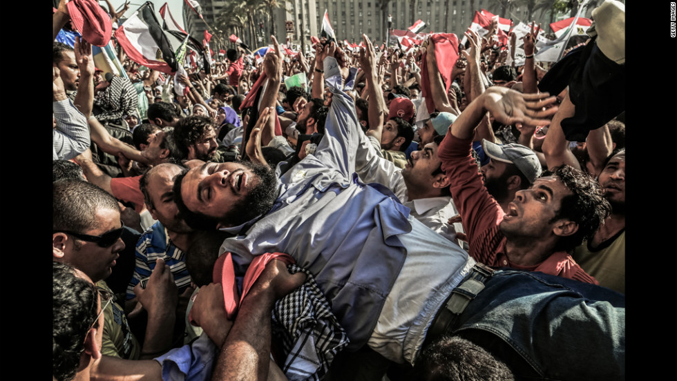 A supporter of the Muslim Brotherhood is carried away from the tightly packed arena of Tahrir Square in Cairo on Sunday as Mohamed Morsi supporters celebrate his victory in Egypt's presidential election.