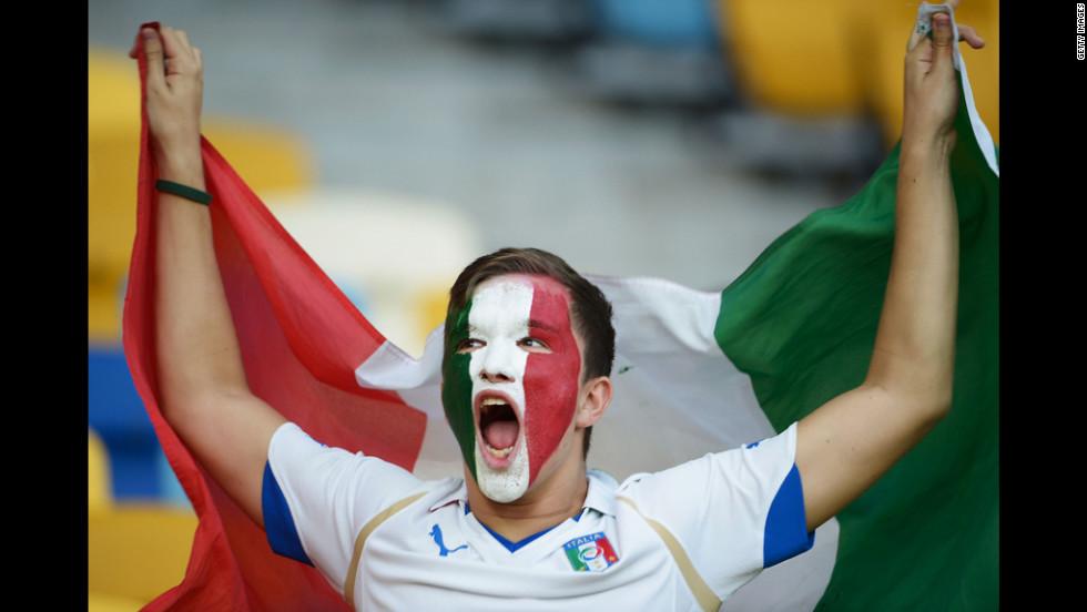 An Italy fan enjoys the atmosphere ahead of Sunday's quarterfinal match.