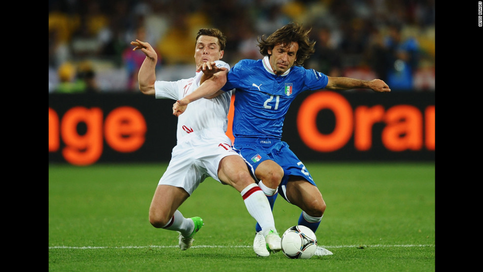 Scott Parker of England and Andrea Pirlo of Italy compete for the ball Sunday.