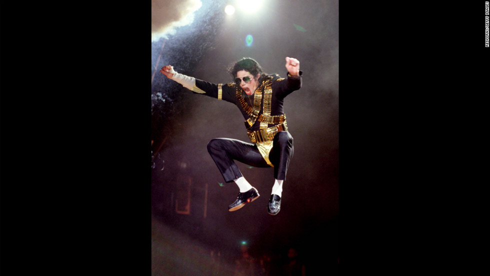 Known for his dance moves, Jackson is seen here jumping in the air while performing during the Dangerous tour in 1992.