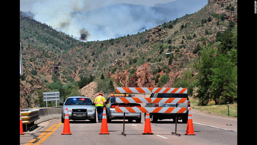 Colorado State Patrol and Colorado Department of Transportation personnel set up a roadblock west of Manitou Springs, Colorado, on Monday, June 25.