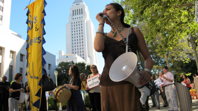 Members of the Coalition for Humane Immigrant Rights of Los Angeles hold a rally and vigil on Monday.