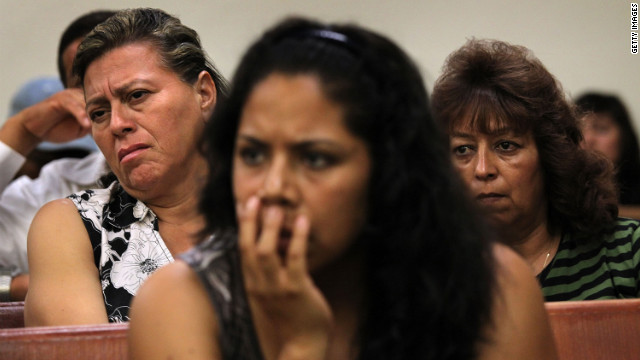 Residents listen as immigrant activists speak about Arizona's law last July.