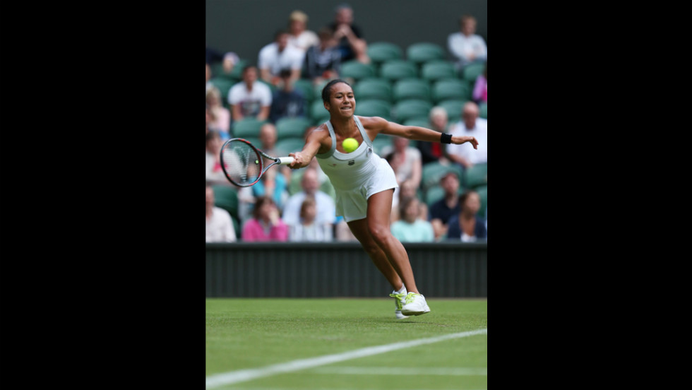 Heather Watson of Great Britain hits a forehand return against Iveta Benesova of the Czech Republic on June 25.