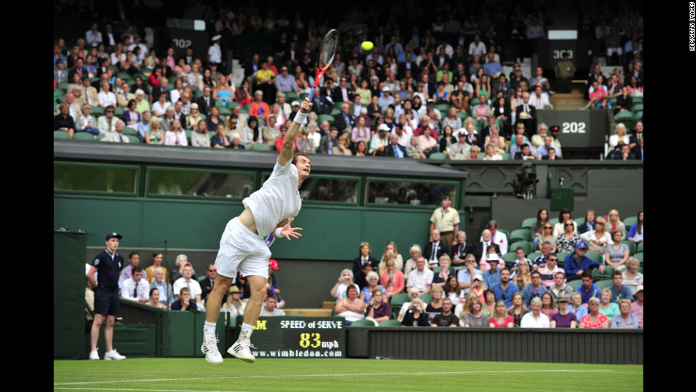 Britain's Andy Murray serves during his first-round singles victory over Russia's Nikolay Davydenko on June 26.