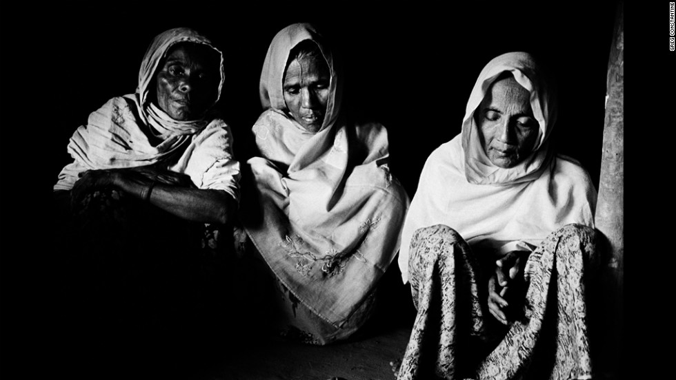 These women claim beatings, extortion and the seizure of their homes forced 120 families to flee their village in Myanmar in early 2009.