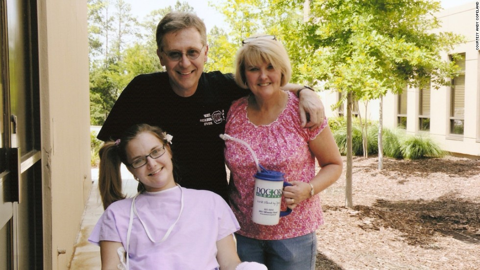 Flesh-eating bacteria patient Aimee Copeland goes outside Doctors Hospital in Augusta, Georgia, for the first time with her parents, Andy and Donna Copeland, on June 25. Copeland was discharged from the hospital in August after a three-month-ordeal.